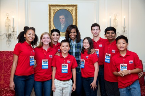 First Lady Michelle Obama joins Scholastic News kid reporters for a group photo following an interview in the Map Room of the White House, Oct. 6, 2016. (Official White House Photo by Amanda Lucidon)